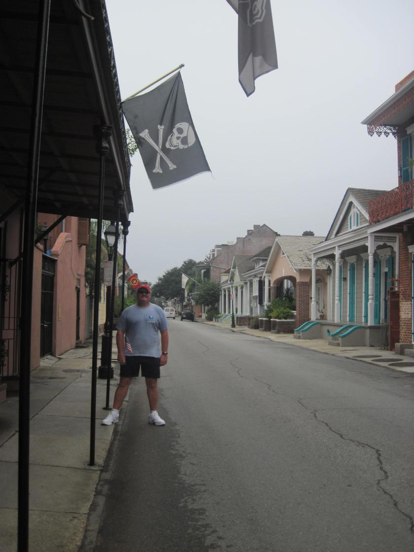Pirate stands under his flag