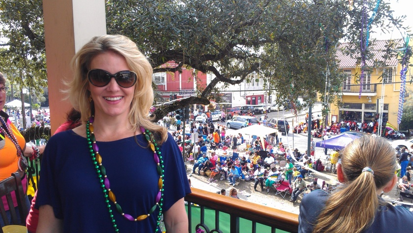Enjoying the view from a balcony on St. Charles.