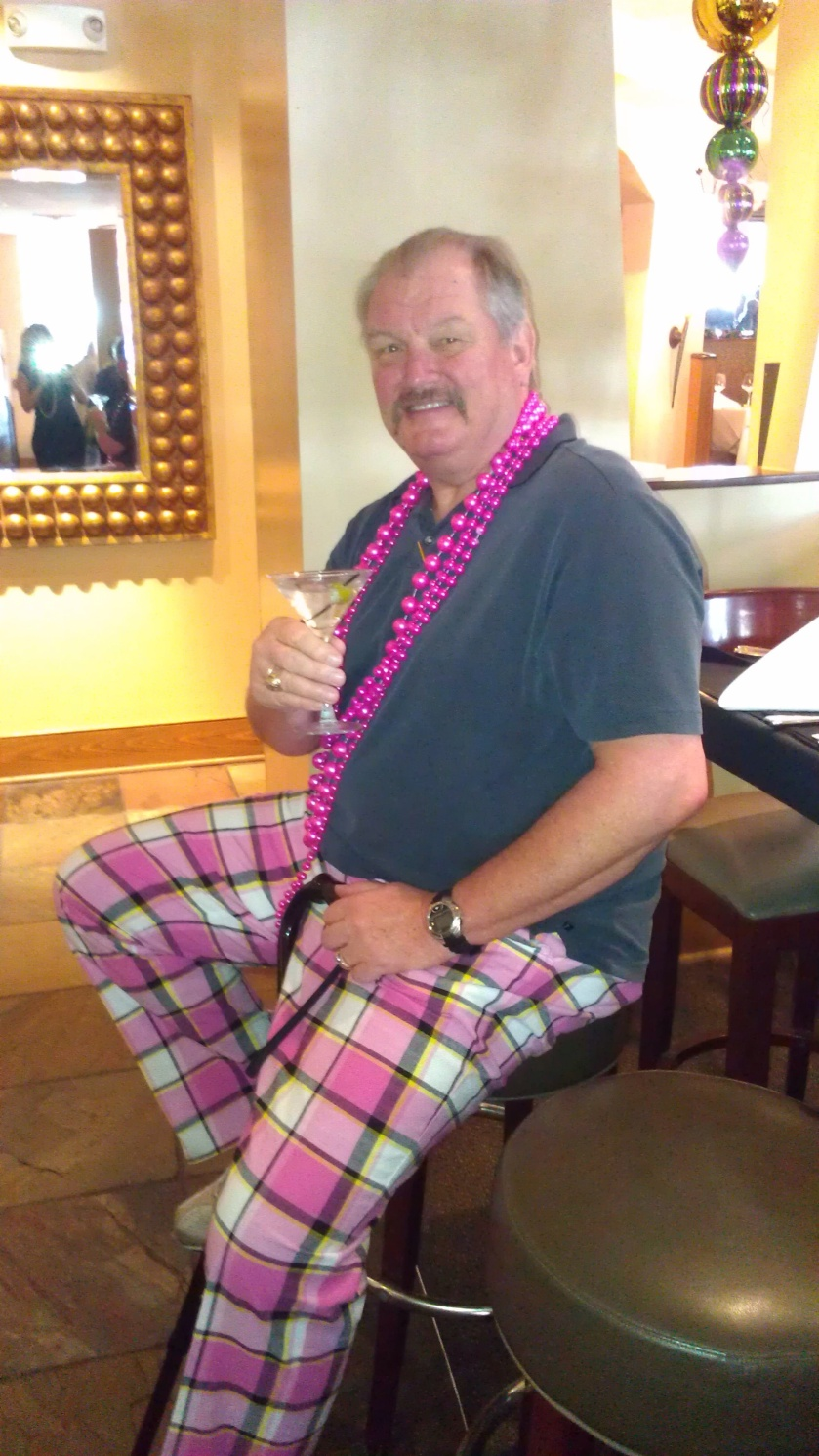 Mardi Gras time and he is out and about!!   A cane and pink pants...